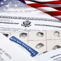 Immigration and Citizenship Papers and documents with US flag
