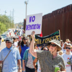 sign that reads no Deportations