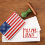 boarding pass with Travel Ban on it
