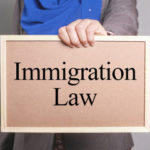 a sign that reads immigration law