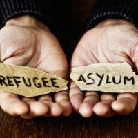 hands holding a Asylum sign