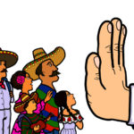 hand that reads immigration making stop sign to immigrants
