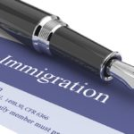 Immigration document with pen on top