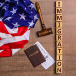 Us flag with immigration sign