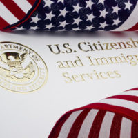 A flag and US citizenship sign
