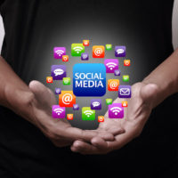 Social Media icons above hands